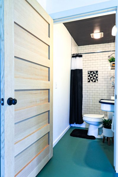 How Woodgrain Doors Warmed Up The Sterile Garage Airbnb